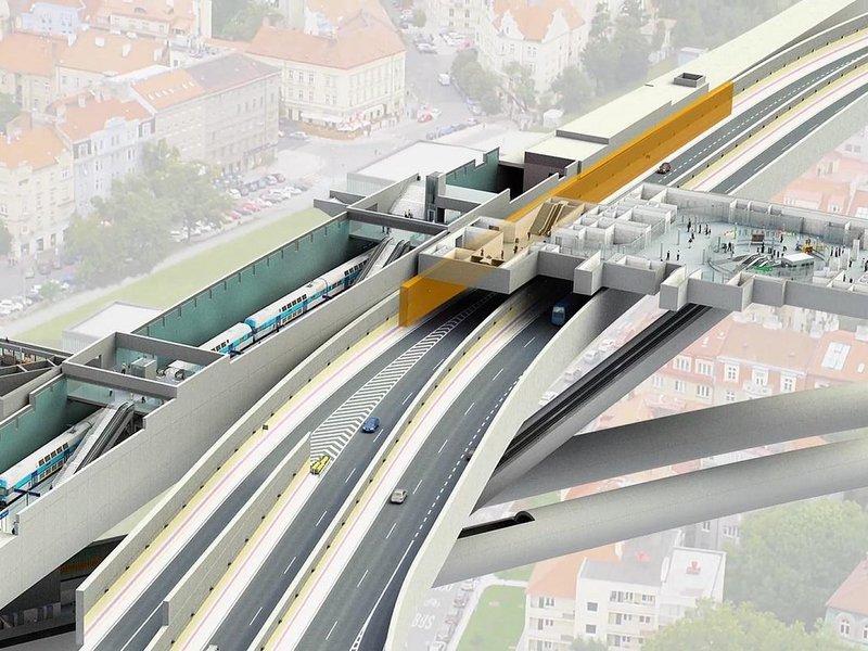 Az ábrán a Várnegyed (Hradčanská) megálló-csomópontot látják. Legalul az A jelzésű (zöld) metróvonal két alagútját látják, a metróhoz vezető mozgólépcsők felett a gépjárműforgalmat vezető Blanka alagút húzódik. Közvetlenül a felszín alatt a földalatti gyalogosátkelő és metróaluljáró tere. A kép baloldalán, a narancssárga támfal mögött, a repülőtér felé vezető vasúti pálya alagútja. Forrás: zeleznicenaletiste.cz